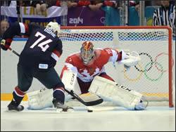 Hockey goalie blocking a shot on goal