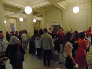 Students and their families mingle during the History Department Graduation Reception at Wisconsin Historical Society