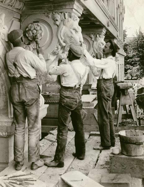 Stone cutters, probably Italian, working on the Library Mall entrance of the State Historical Society building (816 State Street).