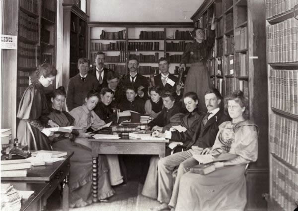 This image shows historian Frederick Jackson Turner and his seminar ca. 1893-1894. Professor Turner is seated second from the right, and the two women standing were staff members.