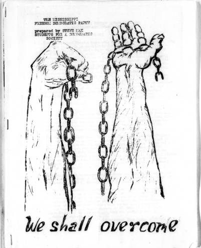 "Item in Freedom Summer Collection, Wisconsin Historical Society. Image is two hand holding chains. Words ""We Shall Overcome"" written on bottom of image."