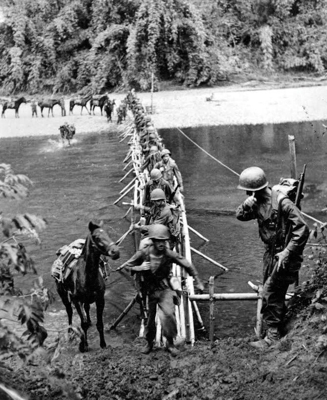 Merrill's Marauder's cross a river in Burma (now Myanmar) in 1944. U.S. Army photo.